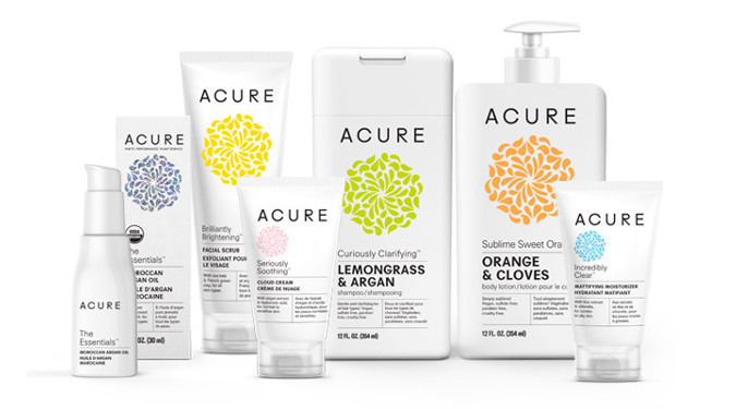 A group of Acure's products with their abstract geometric logo in different colors on the bottles.