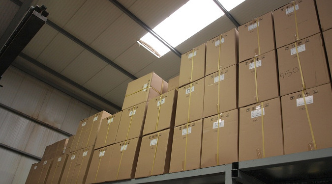 Cardboard Boxes ready for shipping in a warehouse with a skylight.