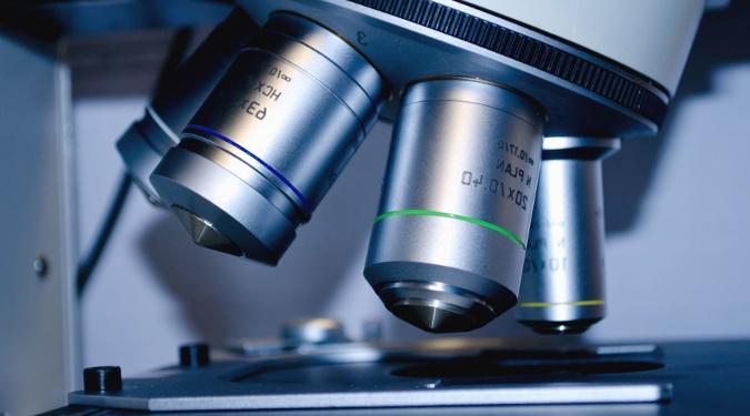 Microscope over a specimen.