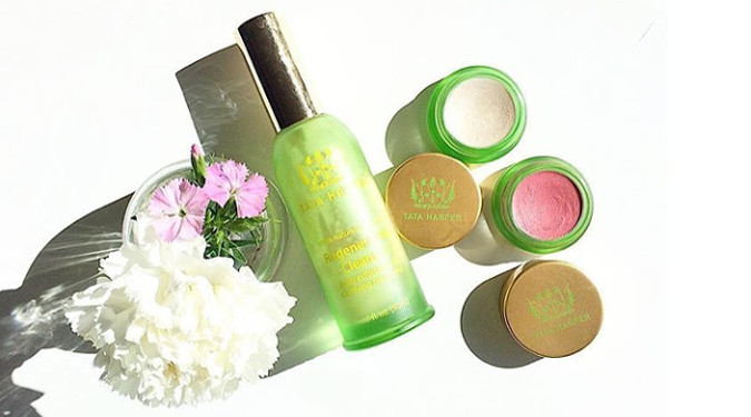 Tata Harper's beautiful products with a flower and shadows.
