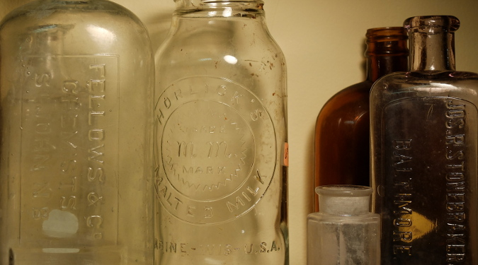Empty apothecary bottles used for holding tinctures and infusions.
