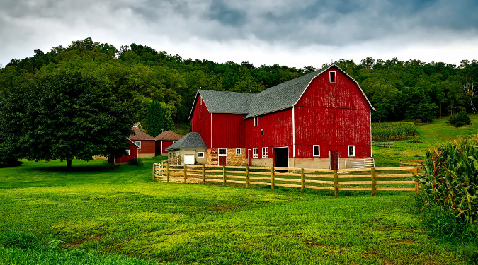 Red Barn on a field, symbolizing Nourish Organic's commitment to USDA certified organic standards.