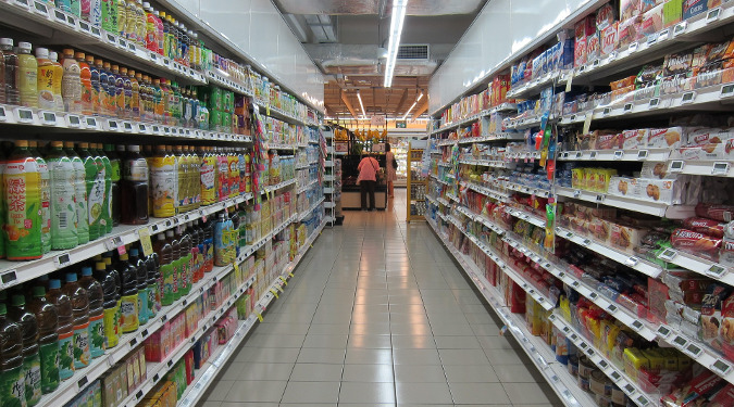 A grocery store aisle with cosmetics. Safer cosmetics with less irritating and questionable ingredients are important.
