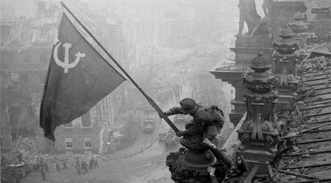 Weleda's survived a Nazi decree to close them down, WWII, economic crises and decades of consumers not understanding the Weleda philosophy. A WWII picture of the Russian flag over the Reichstag.
